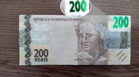 Nota falsa de R$ 200: no detalhe, a falha de impressão – Foto: Divulgação